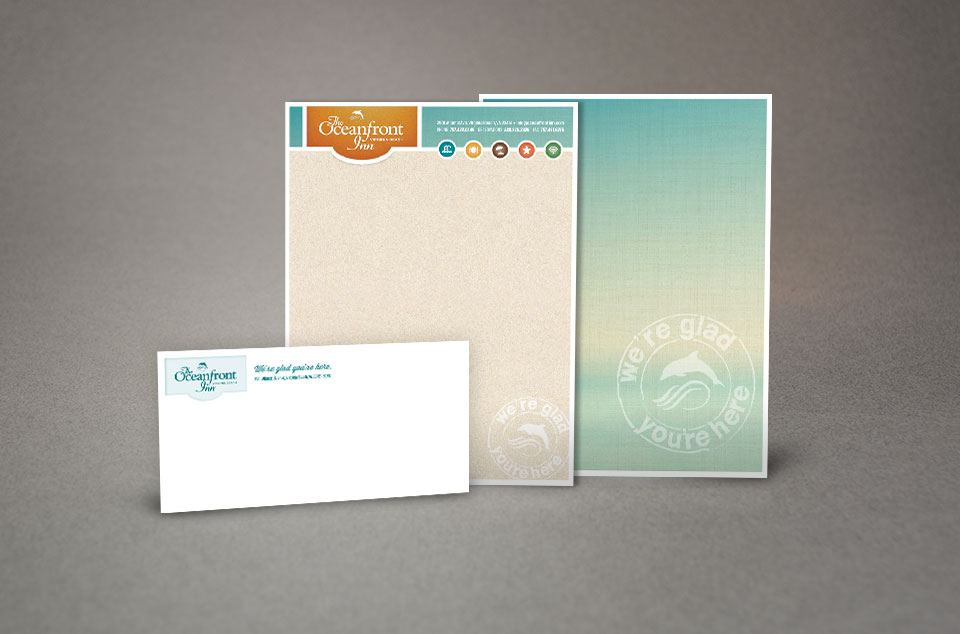Oceanfront Inn stationery suite design of letterhead, envelope, pocket folder by Red Chalk Studios